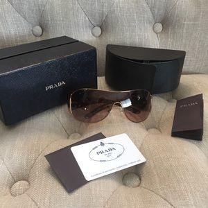 Women's brown Prada Milano sun glasses